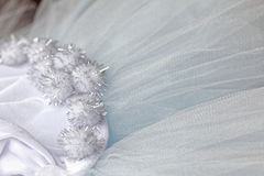 Macro view of sewing dresses. Close Up of fabric mesh for Tutu. Children`s dance skirt. Net wedding textile Stock Images
