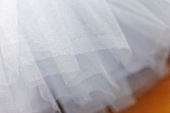 Macro view of sewing dresses. Close Up of fabric mesh for Tutu. Children`s dance skirt. Net wedding textile Stock Photos