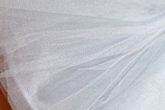 Macro view of sewing dresses. Close Up of fabric mesh for Tutu. Children`s dance skirt. Net wedding textile Stock Image