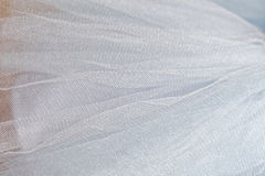 Macro view of sewing dresses. Close Up of fabric mesh for Tutu. Children`s dance skirt. Net wedding textile Stock Photo