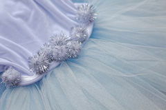 Macro view of sewing dresses. Close Up of fabric mesh for Tutu. Children`s dance skirt. Net wedding textile Royalty Free Stock Photo