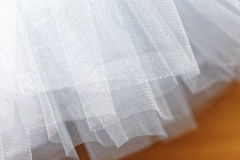 Macro view of sewing dresses. Close Up of fabric mesh for Tutu. Children`s dance skirt. Net wedding textile Royalty Free Stock Images