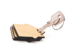 Macro view of silver key with house figure Royalty Free Stock Photos