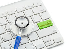 Macro view of a stethoscope on computer keyboard and key botton. With healthcare Stock Photos