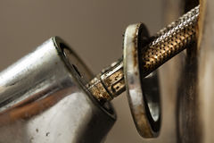Faucet Pipes. Macro view of the two pipes connected to a kitchen sink faucet. In the process of fixing a leak Royalty Free Stock Photos