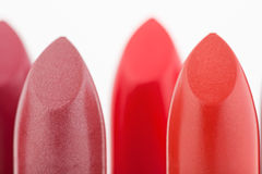 Macro view of two red lipstick heads Royalty Free Stock Images