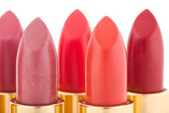 Macro view of two red lipstick heads on white Stock Photography