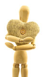 Macro view of wooden male person with knitted woolen heart with Stock Images