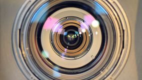 A macro view of a working camera lens. A detailed macro view on a focusing video camera lens stock video footage