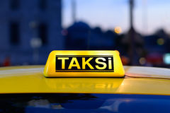Macro view of yellow turkish taxi sign on car . Stock Image