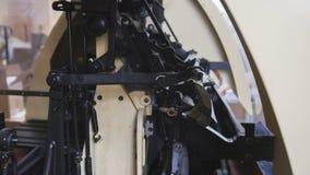 Macro vista del meccanismo nella stamperia, fine del ` s della stampatrice su Immagini Stock