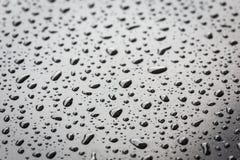 Macro water drop on black stone texture Royalty Free Stock Image