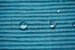 Macro Water Drop on a coloured cloth Royalty Free Stock Images