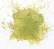 Macro green watercolor splash, isolated on white background Stock Photos