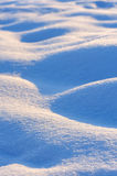 Macro waves of snow bumps Stock Photos
