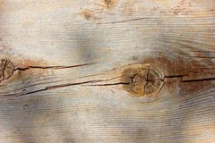 Macro weathered wood grain knot hole plank texture Stock Image