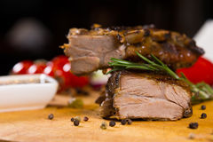 Macro Well Cooked Meat on Wooden Board Royalty Free Stock Images