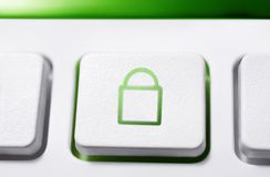 Macro Of A White Button With Green Closed Security Lock Icon. A Macro Of A White Button With Green Closed Security Lock Icon Stock Photography