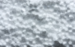 Macro of white plastic foam. Texture of polystyrene foamed plate Stock Photos