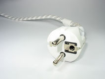 Macro of white two pin plug Royalty Free Stock Images