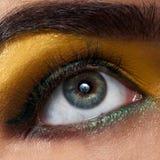 Macro woman eye with yellow makeup Royalty Free Stock Image