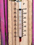 Closeup of a wooden thermometer stock photography