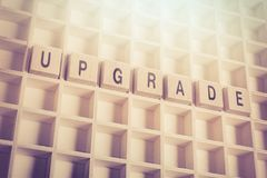 Macro Of The Word Upgrade Formed By Wooden Blocks In A Type Case. A Macro Of The Word Upgrade Formed By Wooden Blocks In A Type Case royalty free stock images