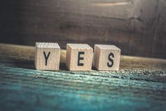 Macro Of The Word Yes Formed By Wooden Blocks On A Wooden Floor Royalty Free Stock Photos