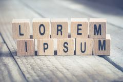 Macro Of The Words Lorem Ipsum Formed By Wooden Blocks On A Wooden Floor. A Macro Of The Words Lorem Ipsum Formed By Wooden Blocks On A Wooden Floor royalty free stock images