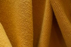 Knit texture background. Macro of yellow or orange Knit fabric texture background Royalty Free Stock Photo