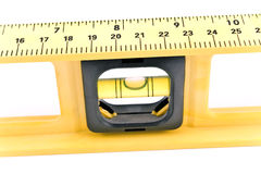 Macro of a yellow spirit level. On white Stock Photography