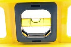 Macro of a yellow spirit level. On white Royalty Free Stock Photos