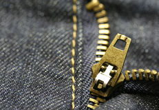 Macro zipper. Macro shot of a zipper from blue jeans Stock Images