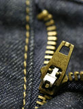 Macro zipper. Macro shot of a zipper from blue jeans Royalty Free Stock Photo