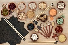 Macrobiotic Diet Food. Macrobiotic diet health food concept with nori seaweed, grains, legumes, seeds, wasabi nuts and vegetables with foods high in fiber, smart royalty free stock photography