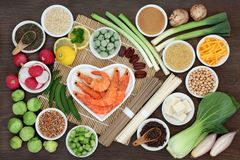 Macrobiotic Diet Health Food. Macrobiotic health food concept with seafood, soba and udon noodles, miso, tofu, kuchika tea, wasabi nuts, vegetables, legumes and Royalty Free Stock Images