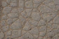 Macroclose-up op concrete asfaltbarsten op de weg Stock Foto