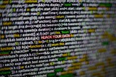 Macrofoto van het computerscherm met programma broncode en benadrukte KAPING UW GEGEVENSinschrijving in het midden Royalty-vrije Stock Fotografie