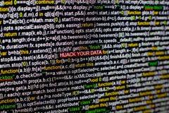 Macrofoto van het computerscherm met programma broncode en benadrukte KAPING UW GEGEVENSinschrijving in het midden Stock Foto's