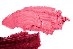 Macrofoto van roze en purpere gesmeerde Lippenstift royalty-vrije stock afbeeldingen