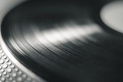 Macrofotografia del disco di musica del vinile immagine stock