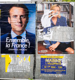 Macron and Le pen posters vandalized in city Royalty Free Stock Images