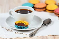 Macrons with a cup of coffee Stock Image