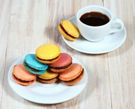Macrons with a cup of coffee Stock Images