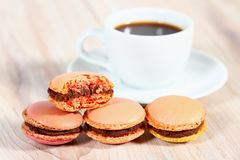 Macrons with a cup of coffee Stock Photo