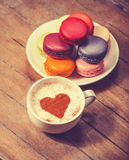 Macrons with cup of coffee Stock Image