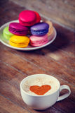 Macrons with cup Stock Photos
