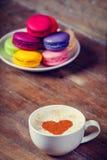Macrons with cup Stock Photos