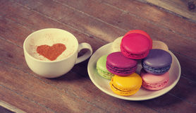 Macrons with cup Royalty Free Stock Photo
