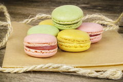 Macrons in various colors on brown paper Stock Photo